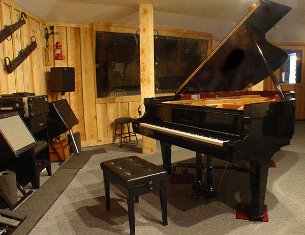 Piano in the foreground, drum isolation booth in the background